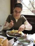 吃妇女 免版税库存照片