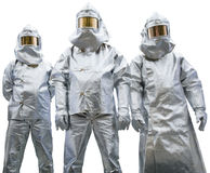 给穿衣的防护三名工作者 库存照片