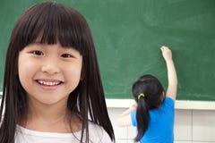 亚裔女孩愉快的学员 库存照片