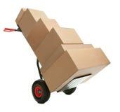 кладет ручную тележку в коробку картона Стоковое Фото