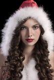 女孩华美的敞篷圣诞老人年轻人 库存图片