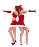 作为摆在圣诞老人秘密性感的妇女的&# 免版税库存照片