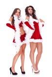 摆在圣诞老人二妇女 免版税库存照片