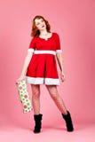 性感女性的圣诞老人 免版税库存照片