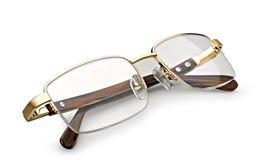 χρυσή ανάγνωση γυαλιών Στοκ φωτογραφία με δικαίωμα ελεύθερης χρήσης