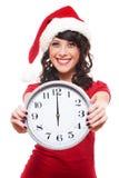 时钟兴奋女孩帽子藏品圣诞老人 免版税图库摄影