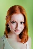 美丽的矮子女孩头发的红色角色 免版税图库摄影