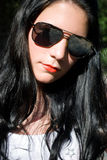 Девушка в солнечных очках Стоковое Изображение RF