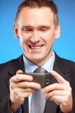 商业他的人移动电话使用 免版税图库摄影