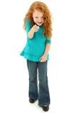 照相机嬉戏地指向幼稚园的儿童女孩 免版税库存图片