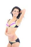 夏天泳装比基尼泳装的深色的妇女 免版税库存图片