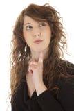有吸引力的认为的妇女年轻人 免版税图库摄影