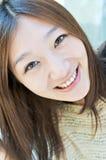 东亚女孩微笑的表面 免版税库存图片