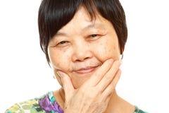 资深亚洲人用手 免版税库存图片