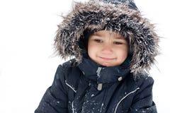 男孩快乐的孩童用防雪装 免版税库存照片