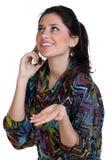 愉快的妇女叫由电话 免版税库存照片
