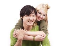夫妇愉快的混杂的年轻人 免版税库存图片