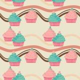 无缝蓝色杯形蛋糕的粉红色 图库摄影