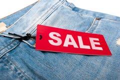 牛仔裤销售额标签 图库摄影