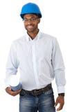 有图纸的微笑的建筑师 免版税图库摄影