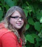 青少年女孩的玻璃 免版税库存照片