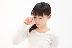 женщины касания глаза Стоковая Фотография RF