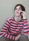移动电话少年 免版税库存图片