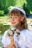 去圣餐第一个的女孩圣洁 免版税库存图片