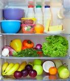 食物充分的健康冰箱 免版税库存图片