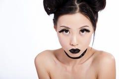 亚洲黑色创造性的女性构成年轻人 免版税库存图片