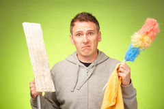 不快乐的人清洗房子 免版税图库摄影