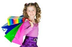 女孩拿着许多程序包 免版税库存照片