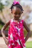 非洲裔美国人的逗人喜爱的女孩少许纵向 图库摄影