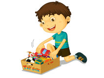 男孩他的玩具 免版税库存照片