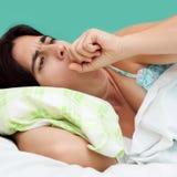 咳嗽西班牙纵向妇女 图库摄影