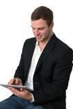 生意人个人计算机片剂运作的年轻人 免版税库存图片