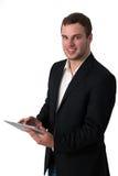 生意人个人计算机片剂运作的年轻人 免版税图库摄影