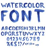 字母表蓝色手写的水彩 免版税图库摄影