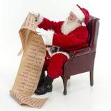 检查他的列表圣诞老人 免版税库存照片