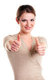 愉快的显示的符号赞许妇女年轻人 免版税图库摄影