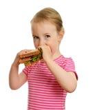吃女孩少许三明治年轻人 库存照片