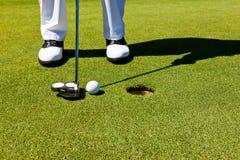 高尔夫球绿色放置 免版税库存图片