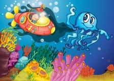 在潜水艇的章鱼和孩子 免版税库存照片