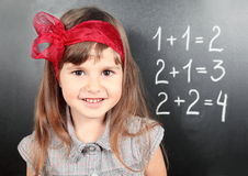 了解数学的黑板女孩近 图库摄影