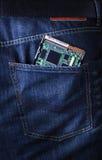 在牛仔裤矿穴的个人计算机硬盘驱动器 库存图片