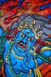 被雕刻的藏语 免版税库存图片