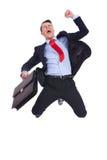 有公文包的超级兴奋商人 免版税库存图片