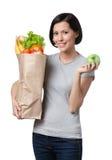 亭亭玉立的妇女用健康食物 库存照片