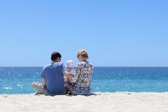 Семья на пляже Стоковая Фотография