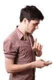 年轻人藏品移动电话 库存照片